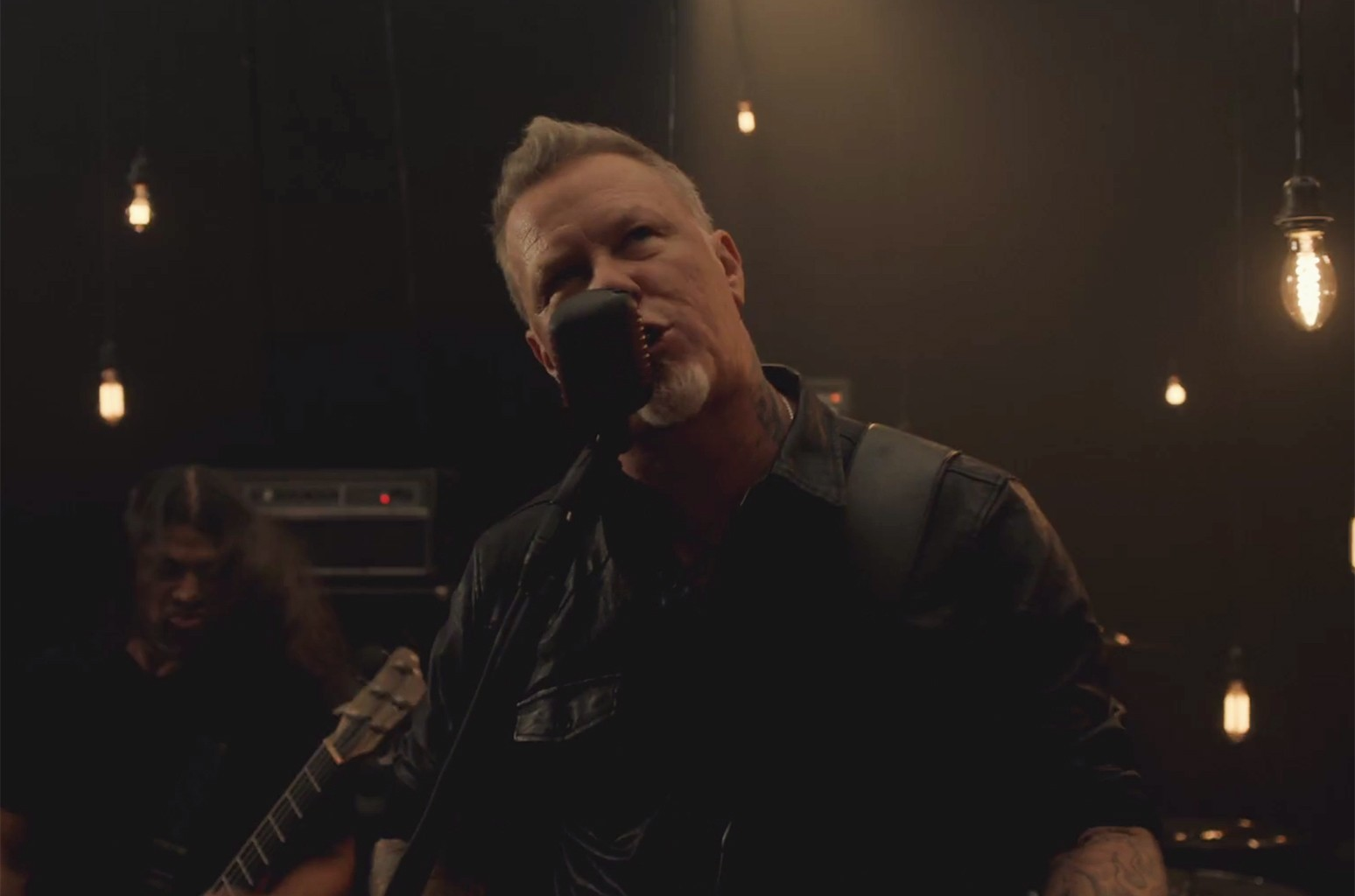 Metallica in the video for Moth Into Flame