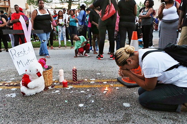 Mourners at Michael Brown shooting location in Ferguson, Missouri
