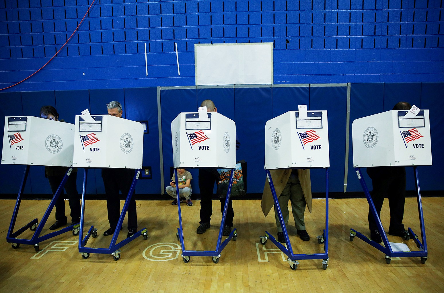 Voters cast their ballots during the midterm election at the High School Art and Design polling station in Manhattan, New York, United States on Nov. 6, 2018.