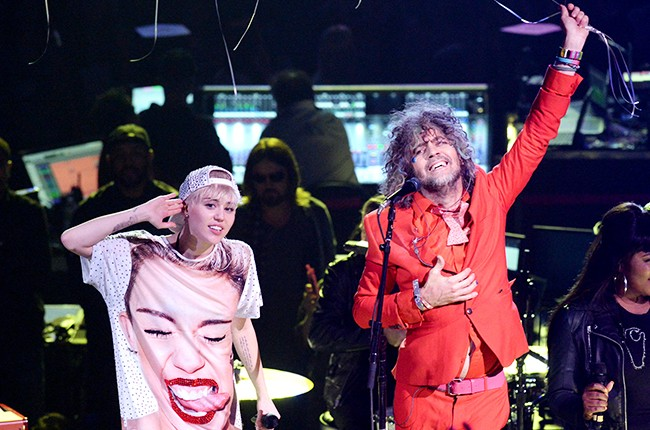 Miley Cyrus and Wayne Coyne perform at Staples Center on February 22, 2014 in Los Angeles