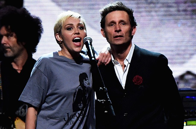 Miley Cyrus and Mike Dirnt perform onstage with inductee Ringo Starr during the 30th Annual Rock And Roll Hall Of Fame Induction Ceremony
