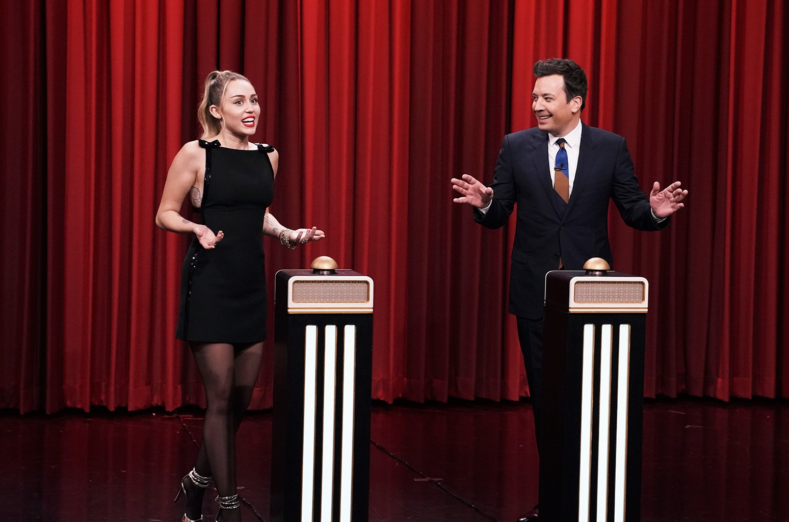 """Miley Cyrus and host Jimmy Fallon during """"Name That Song Challenge"""" on The Tonight Show Starring Jimmy Fallon on Dec. 13, 2018."""