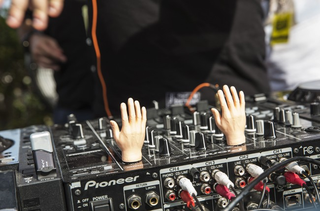 Miniature hands on the mixing decks at Red Bull Guest House in Miami