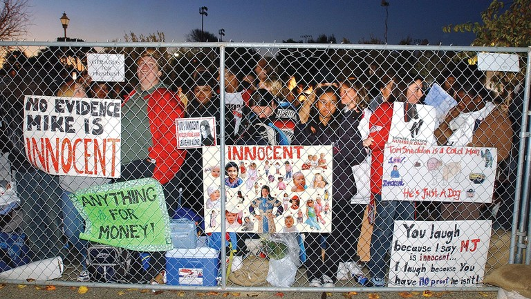 <p>Jackson supporters turned up before sunrise outside the Santa Maria, Calif., courthouse before his arrival on Jan. 16, 2004. Two days later, he would plead not guilty to seven felony counts of child molestation.</p>