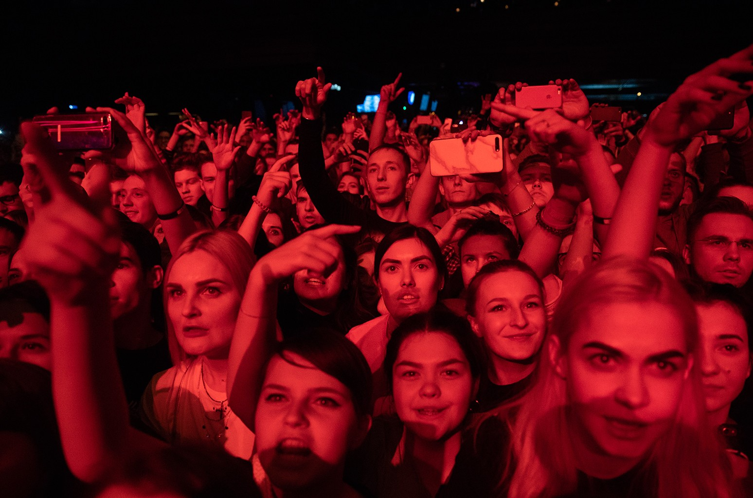 People cheer during a concert in support of rapper Husky, in Moscow on Dec. 26, 2018.