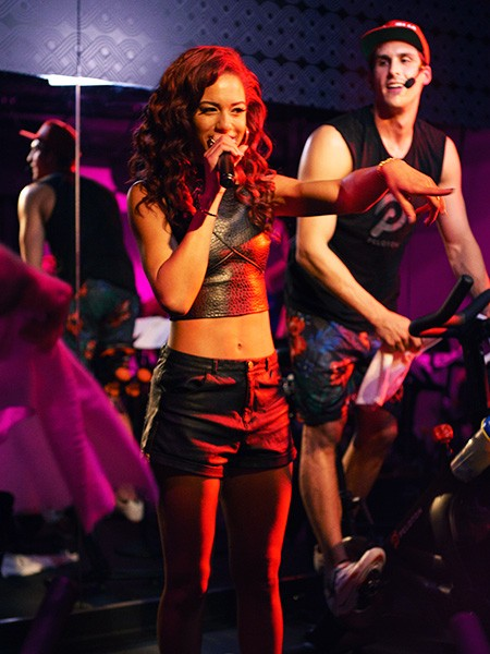 """Natalie La Rose surprises a Republic Records hosted spin class with a performance of """"Somebody"""" at Peloton in New York on May 6, 2015."""