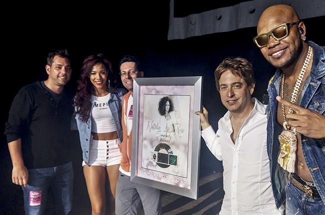 Natalie La Rose surprised with platinum plaque presentation by Flo Rida and Republic Records EVP Charlie Walk on stage at WBLI's Summer Jam
