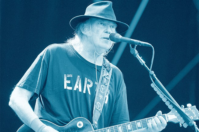 Neil Young performing on July 28, 2014.