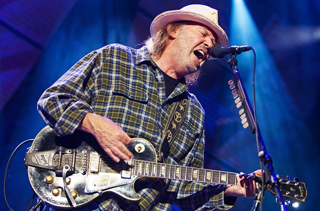 Neil Young performs at Farm Aid 25: Growing Hope for America at Miller Park on October 2, 2010