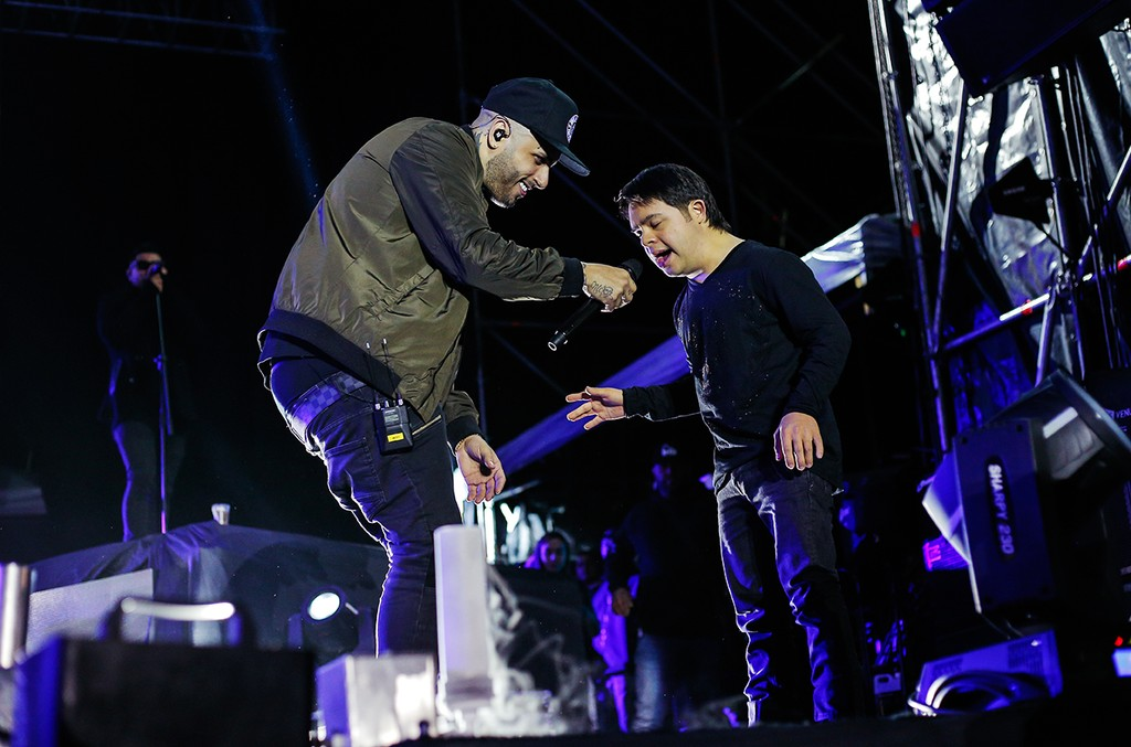 Nicky Jam greets fan onstage during a private showcase on Feb. 17, 2017 in Miami.