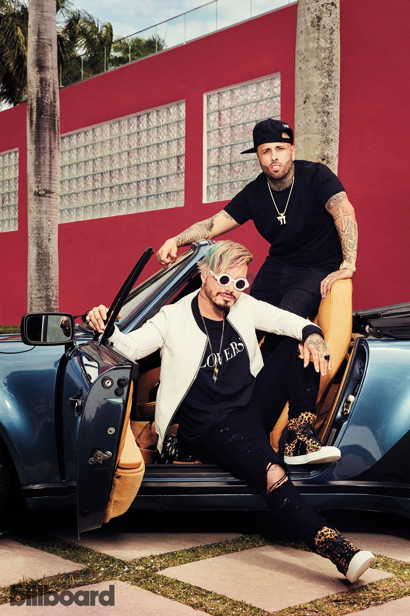 J Balvin (left) and Nicky Jam photographed on April 17, 2017 in Miami. Styling by Shannon Adducci. Nicky Jam wears a City Lab T-shirt and Sal the Jeweler necklace. Balvin wears an AMIRI T-shirt, 3.1 Phillip Lim jacket and Gosha Rubchinskiy sunglasses.