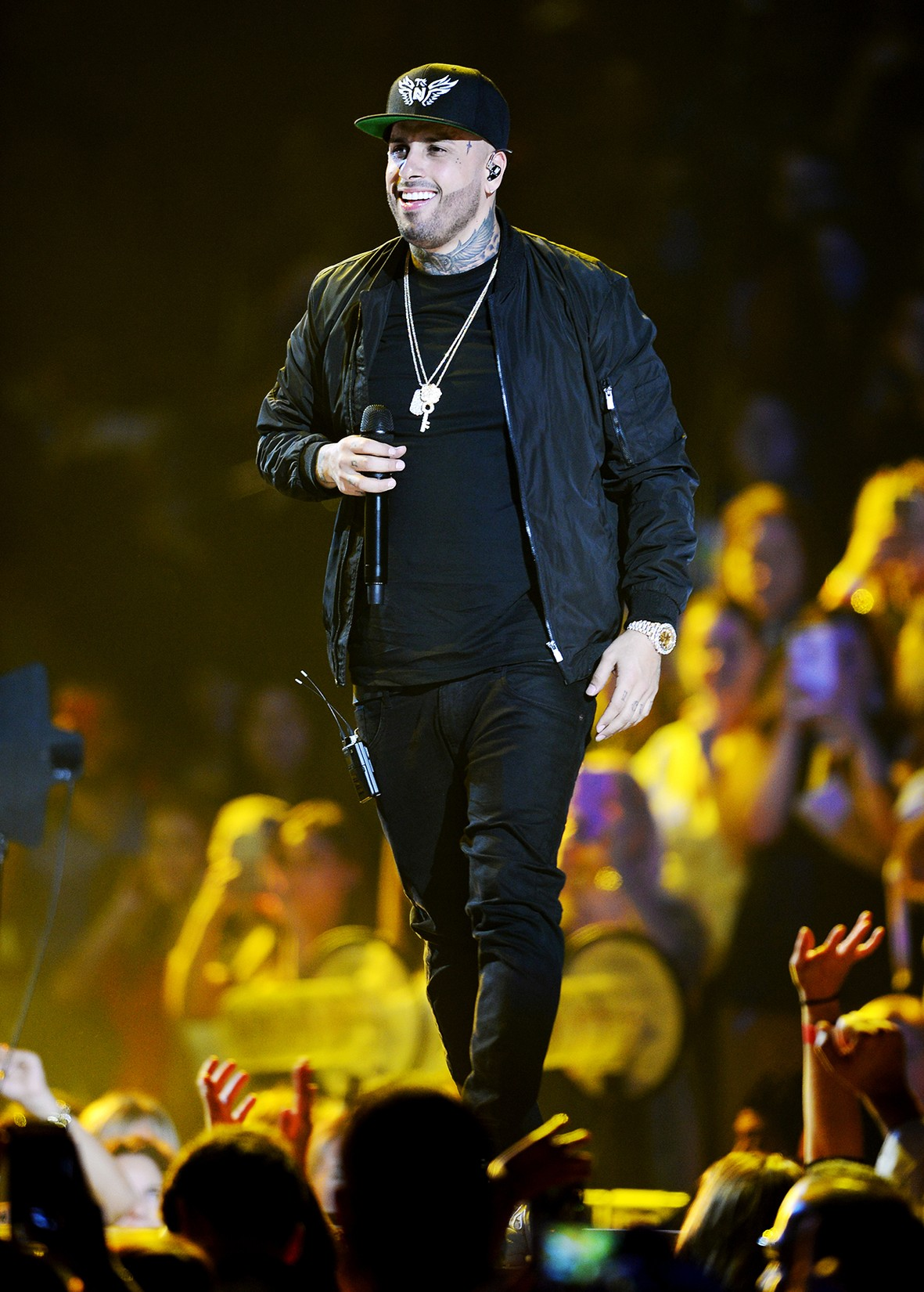Nicky Jam performs on stage at iHeartRadio Fiesta Latina at American Airlines Arena on Nov. 5, 2016 in Miami.