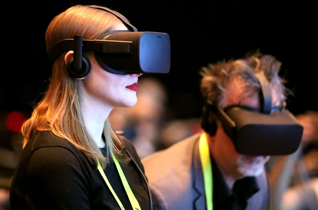 People use Oculus Rift VR headset to experience 3D virtual reality during the Intel press conference at the 2017 International Consumer Electronics Show in Las Vegas on Jan. 4, 2017.
