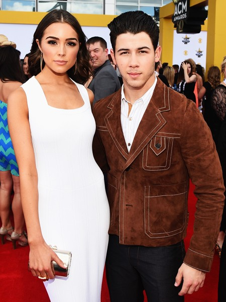 Olivia Culpo and Nick Jonas attend the 50th Academy Of Country Music Awards 2015