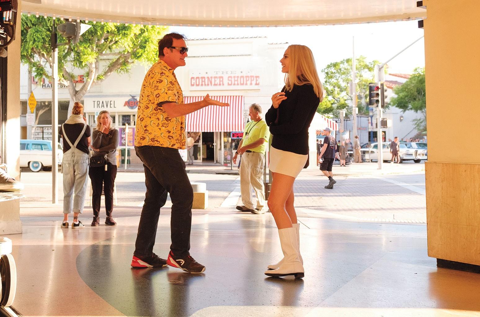 Tarantino (left) and Robbie on the set.