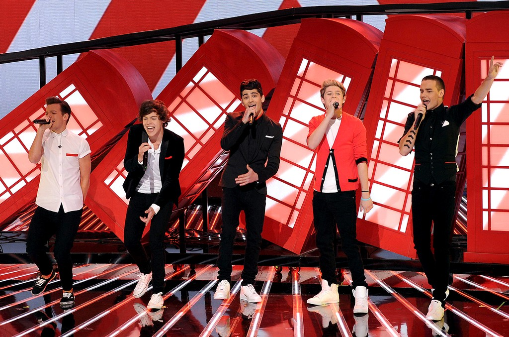 "Louis Tomlinson, Harry Styles, Zayn Malik, Niall Horan and Liam Payne of British singing group One Direction performs on FOX's ""The X Factor"" Season 2 Top 13 To 12 Live Elimination Show on Nov. 8, 2012 in Hollywood, Calif."