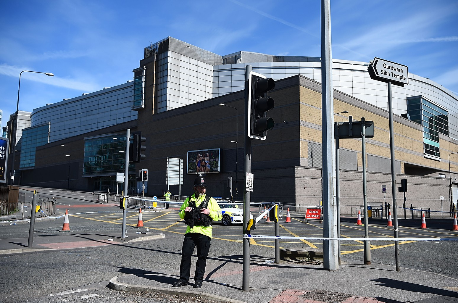 A Police officer stands guard near the Manchester Arena on May 23, 2017 in Manchester, England.  At least 22 people were killed in a suicide bombing at an Ariana Grande concert at Manchester Arena which was packed with children.