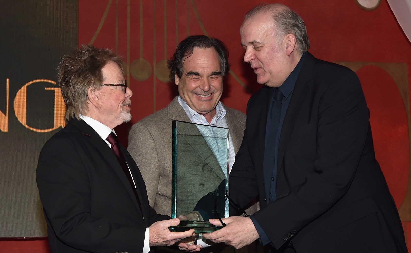 Craig Armstrong accepts the Henry Mancini Award from ASCAP President and Chairman Paul Williams and director Oliver Stone during the 2016 ASCAP Screen Music Awards