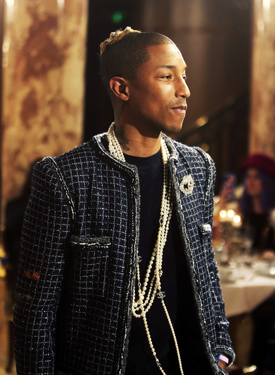 Pharrell Williams attends Chanel's Arts et Metiers fashion collection presented in Paris, France on Dec. 6, 2016.