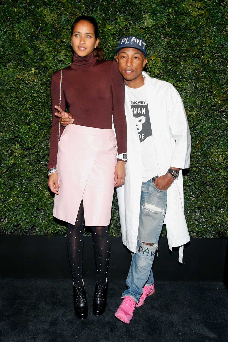 Pharrell Williams and Helen Lasichanh attends the Charles Finch and Chanel Pre-Oscar Awards Dinner in Los Angeles on Feb. 27, 2016.