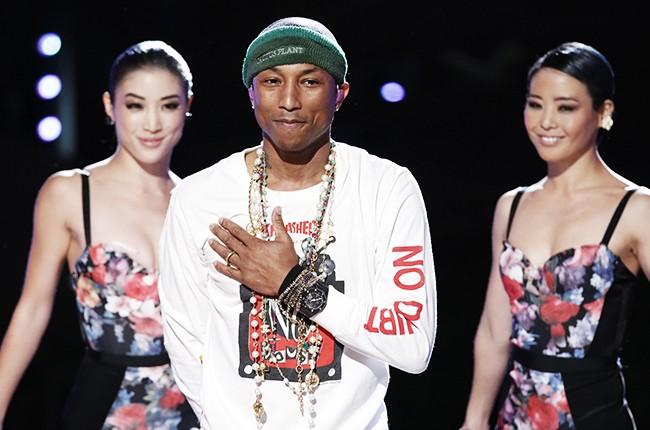 Pharrell Williams performs on NBC's ?The Voice? on Nov. 11, 2014.