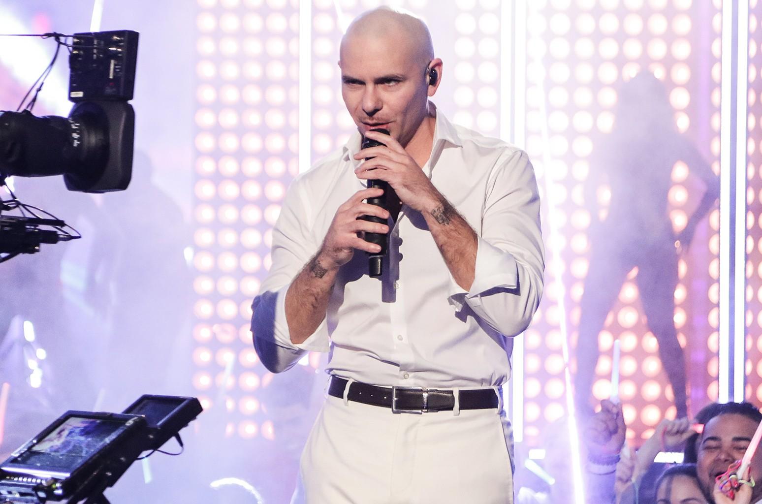 Pitbull performs at Univision Studios