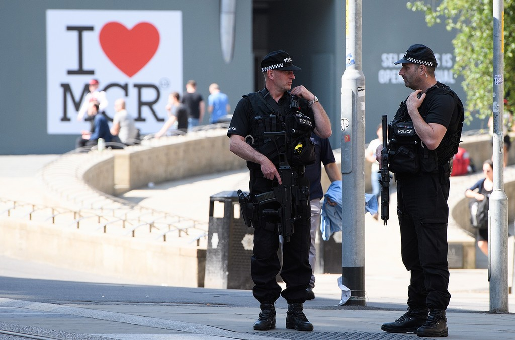 Armed police patrol the city centre ahead of a national minute's silence in remembrance of all those who lost their lives in the Manchester Arena attack, on May 25, 2017 in Manchester, England.