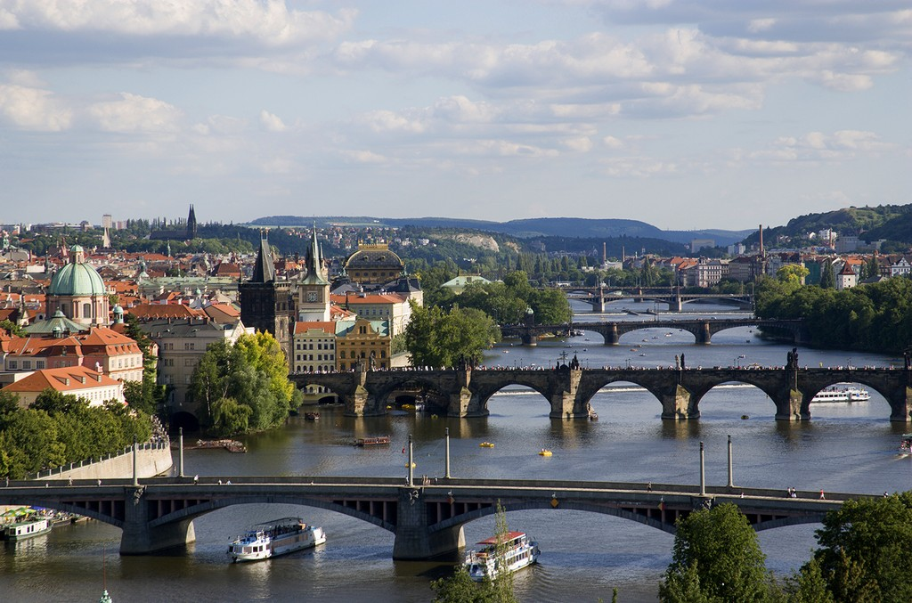The city skyline across the Vtlava River in Prague.