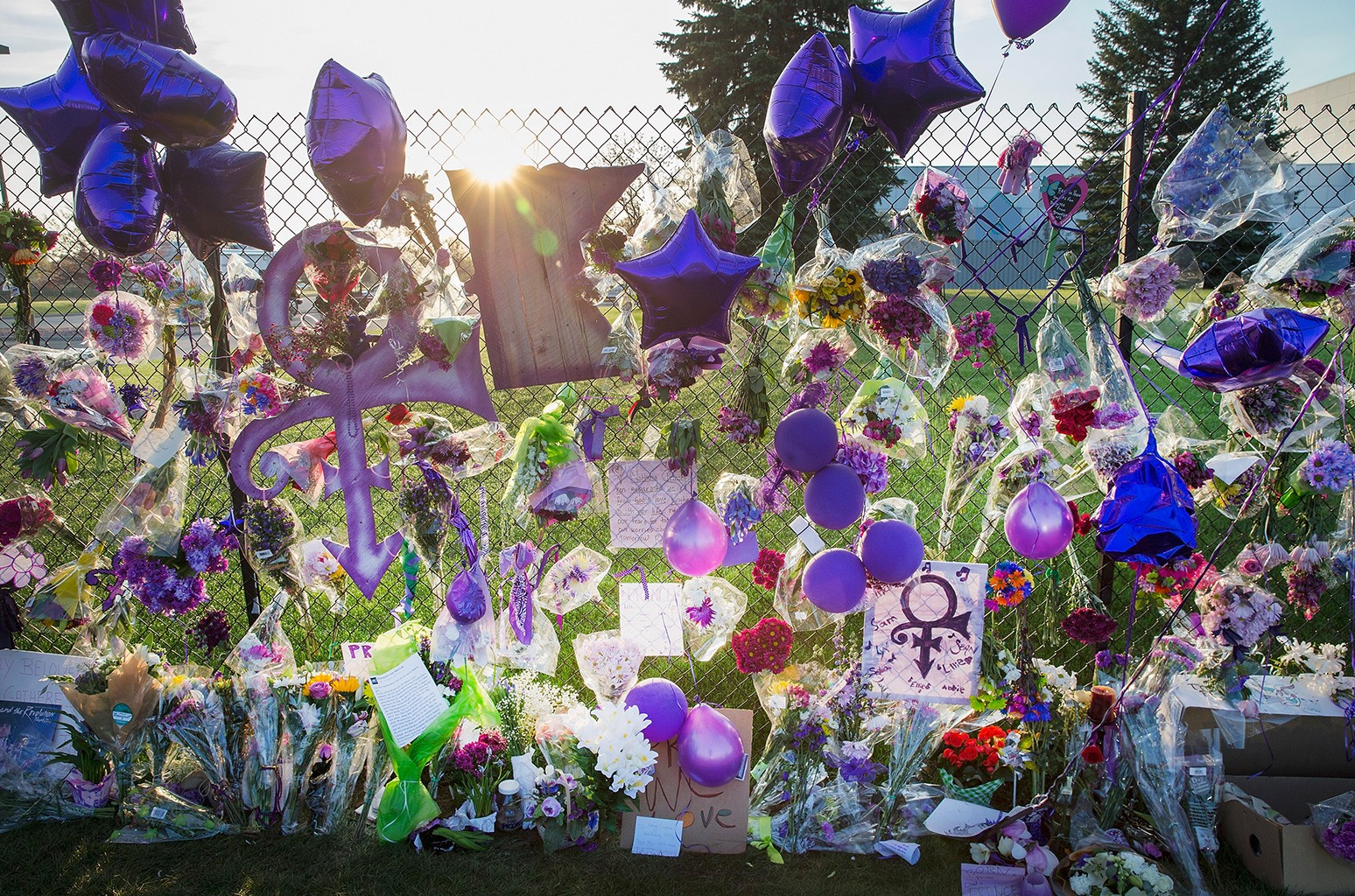 Mementos left by fans are attached to the fence which surrounds Paisley Park, the home and studio of Prince, on April 23, 2016 in Chanhassen, Minnesota.