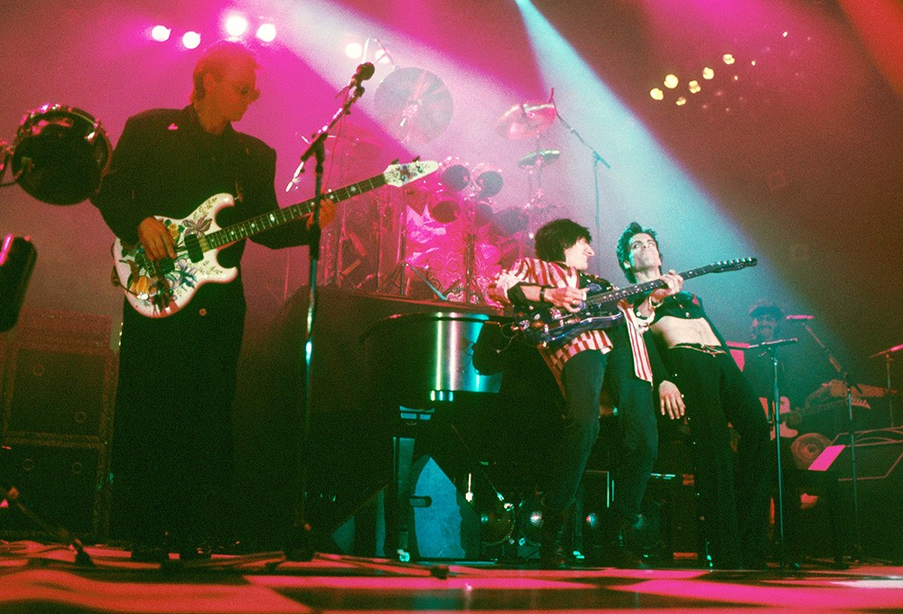 Sting and Ron Wood perform on stage with Prince