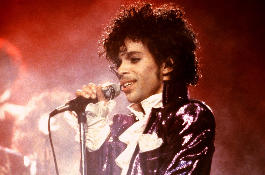 Prince performs during the Purple Rain tour.