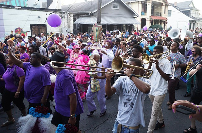 Thousands of locals celebrate the life of Prince at the second line memorial parade  on April 25, 2016 in New Orleans, Louisiana.