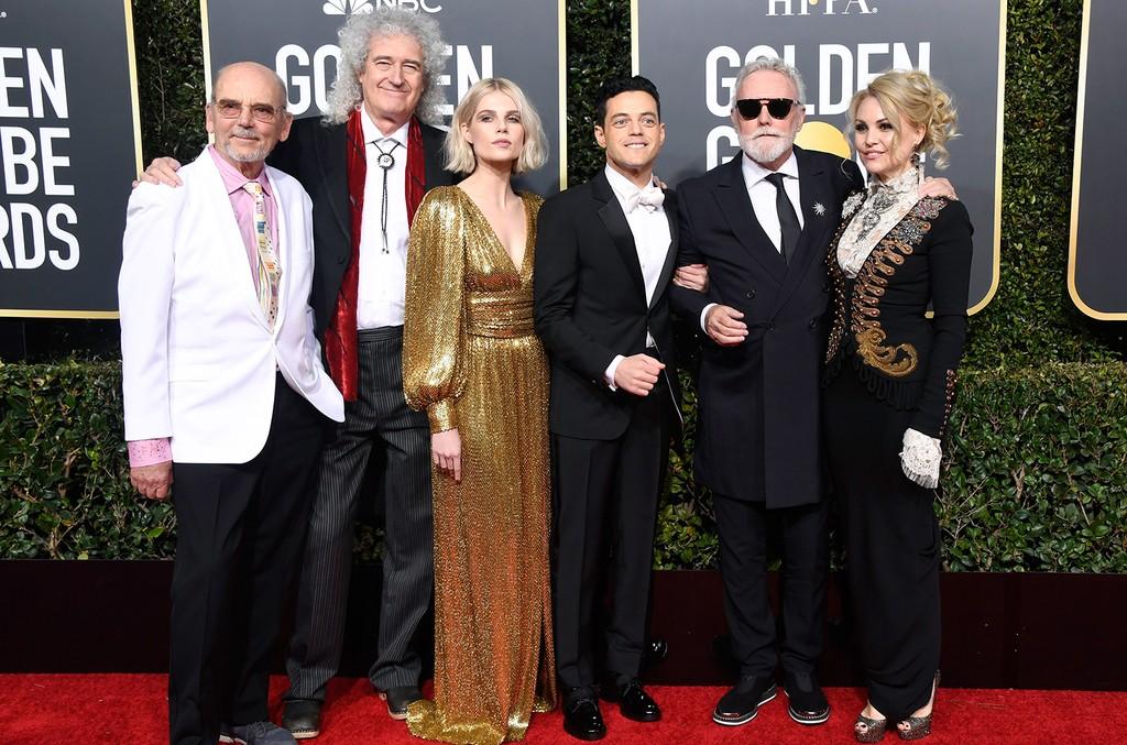 Jim Beach, Brian May of Queen, Lucy Boynton, Rami Malek, Roger Taylor of Queen & Sarina Potgieter