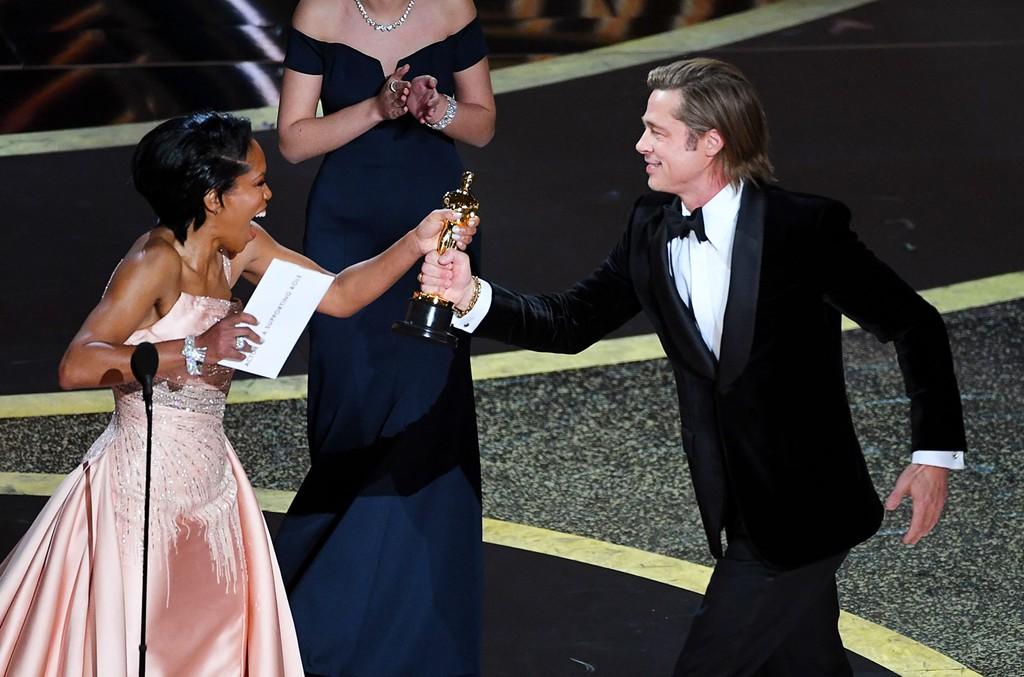 Regina King and Brad Pitt