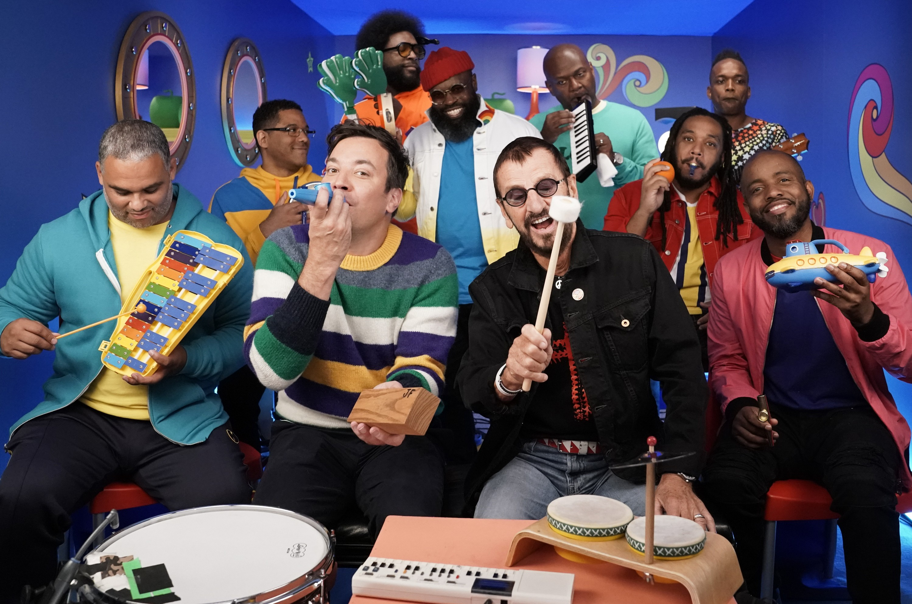 """Host Jimmy Fallon and Ringo Starr during """"Yellow Submarine Classroom Instruments"""" with The Roots on September 24, 2019."""