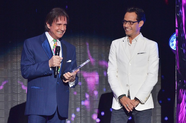 Roberto Carlos receives award by Marc Anthony at the 2015 Billboard Latin Music Awards
