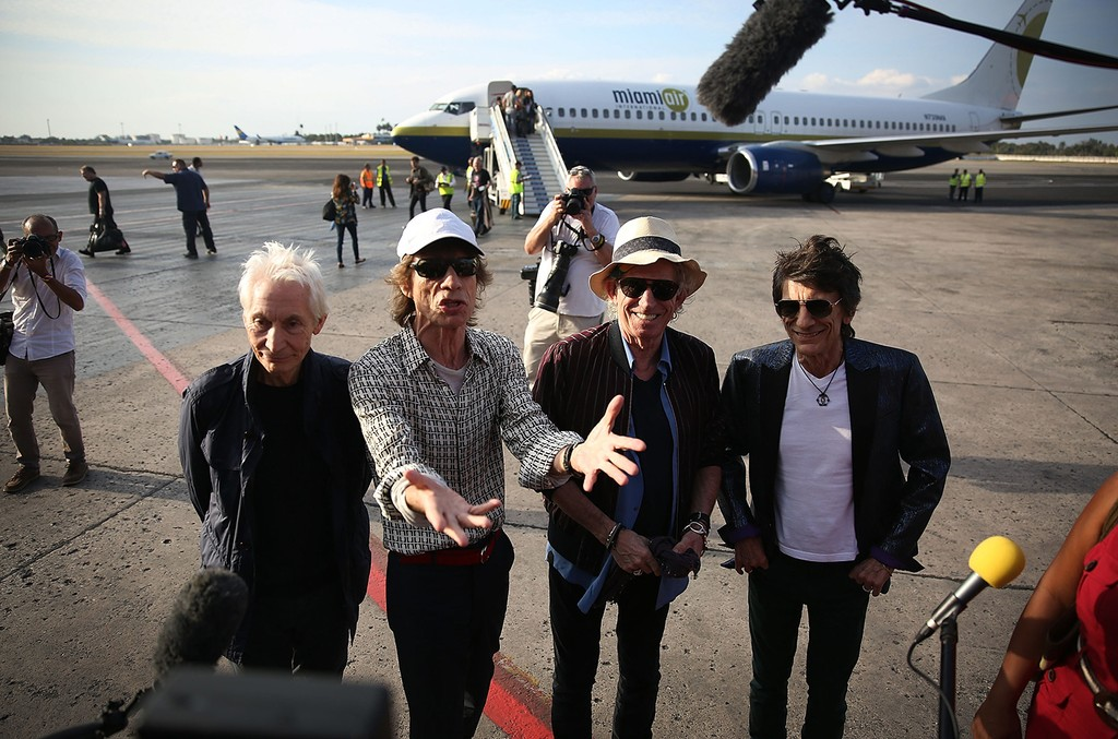 (L-R) Charlie Watts, Mick Jagger, Keith Richards and Ronnie Wood of the Rolling Stones talk to media after landing at the Jose Marti International Airport on March 24, 2016 in Havana, Cuba.