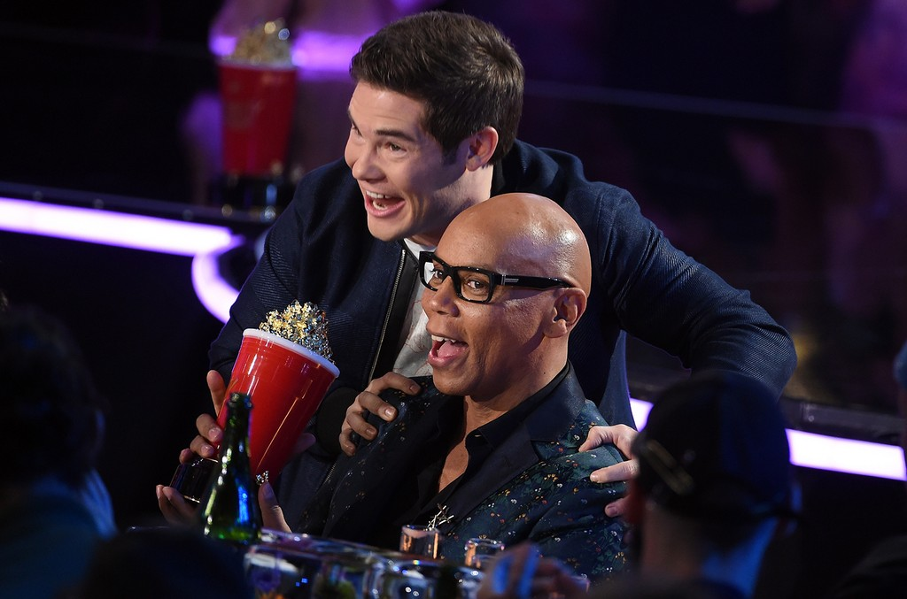 Host Adam Devin presents the Best Reality Competition award to RuPaul for RuPaul's Drag Race in the audience during the 2017 MTV Movie and TV Awards at The Shrine Auditorium on May 7, 2017 in Los Angeles.
