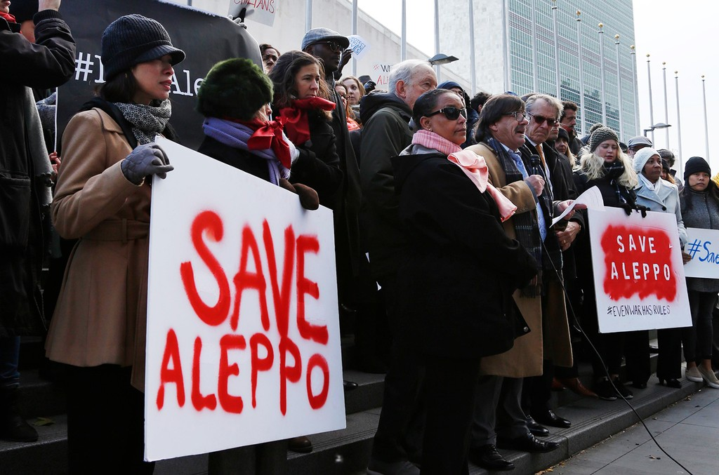 United Nations staff and other supporters assemble in front of U.N. headquarters to show their solidarity with the people of Aleppo, Syria on Dec. 15, 2016.