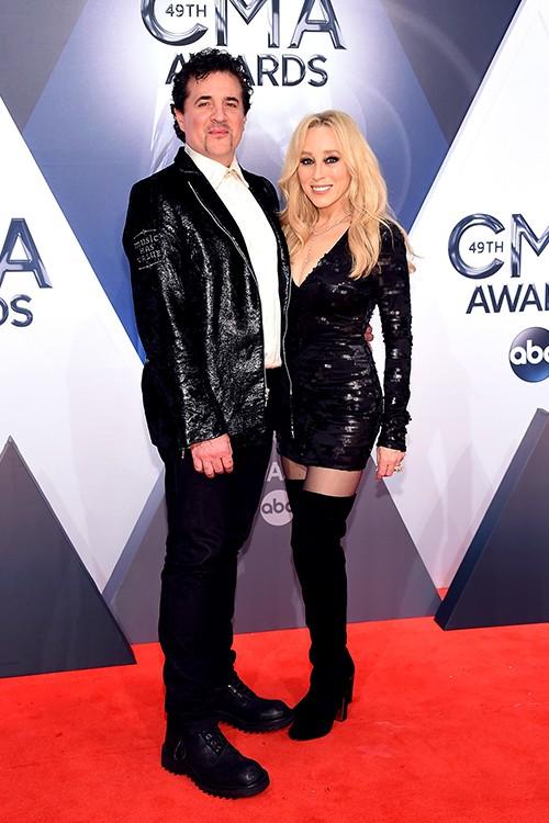 Scott Borchetta and Sandi Spika Borchetta attend the 49th annual CMA Awards