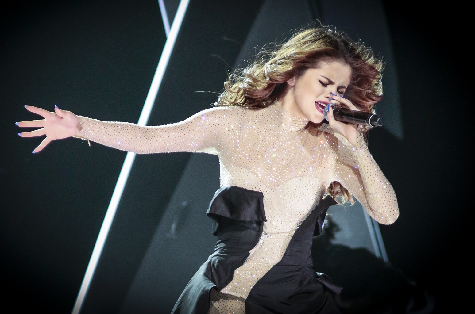Selena Gomez performs onstage during her Revival Tour