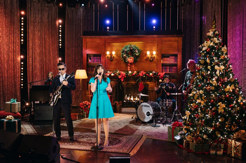She & Him, M. Ward and Zooey Deschanel, performs during The Late Late Show with James Corden Dec. 12, 2016.