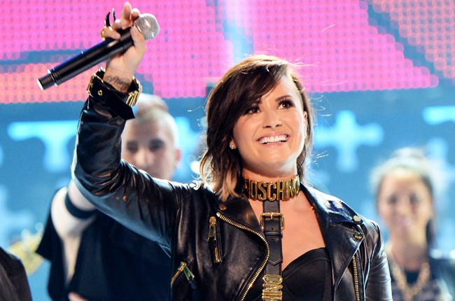 "Demi Lovato performs ""Really Don't Care"" during FOX's 2014 Teen Choice Awards"