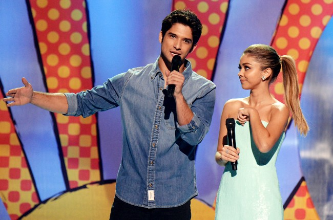 Hosts Tyler Posey and Sarah Hyland onstage during FOX's 2014 Teen Choice Awards