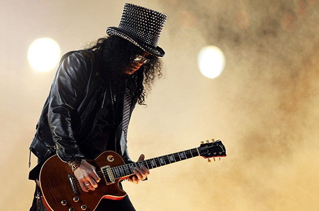Slash performs with the Black Eyed Peas during the Bridgestone Super Bowl XLV Halftime Show