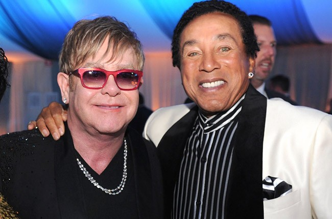 Elton John and Smokey Robinson attend the 20th Annual Elton John AIDS Foundation Academy Awards Viewing Party at The City of West Hollywood Park on February 26, 2012 in Beverly Hills, California.