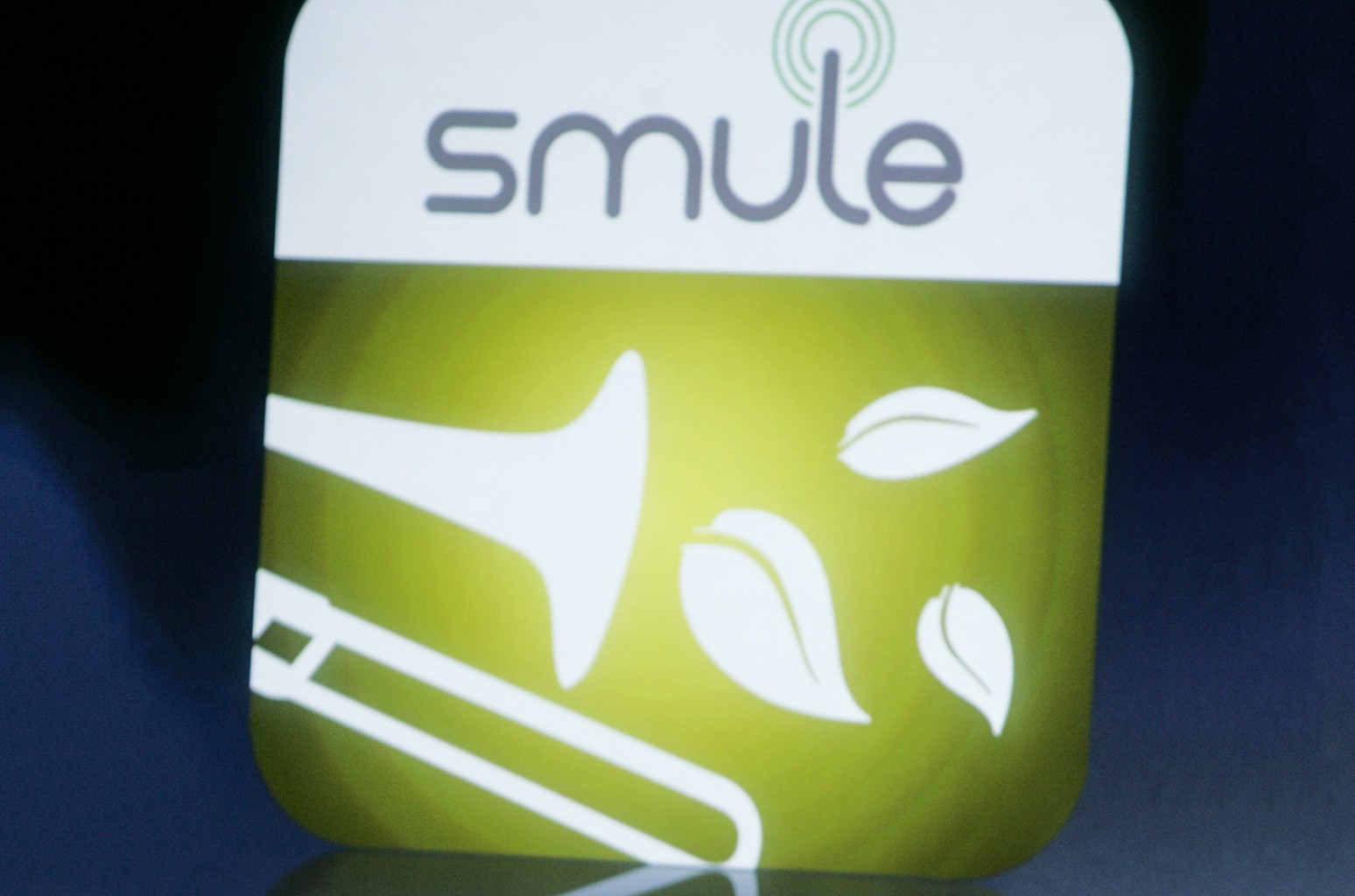 The Smule app logo shown on a screen at Apple headquarters in Cupertino, Calif.