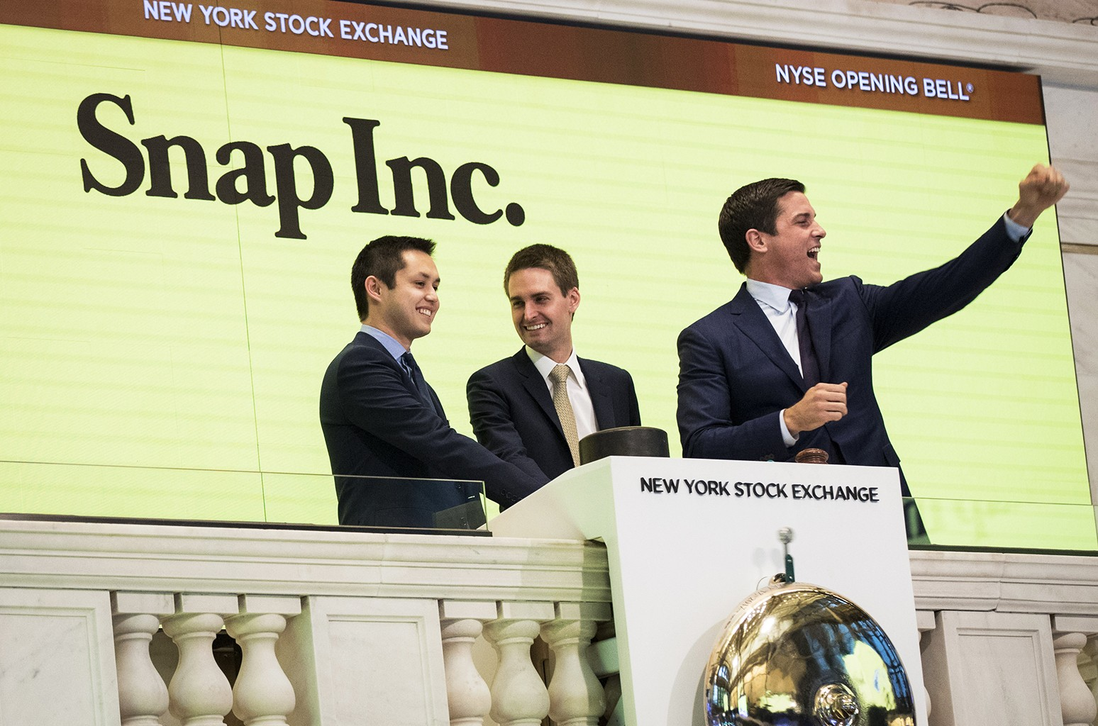 Snapchat co-founders Bobby Murphy, chief technology officer of Snap Inc., and Evan Spiegel, chief executive officer of Snap Inc., ring the opening bell as Thomas Farley, president of the NYSE, looks on, on March 2, 2017 in New York City.