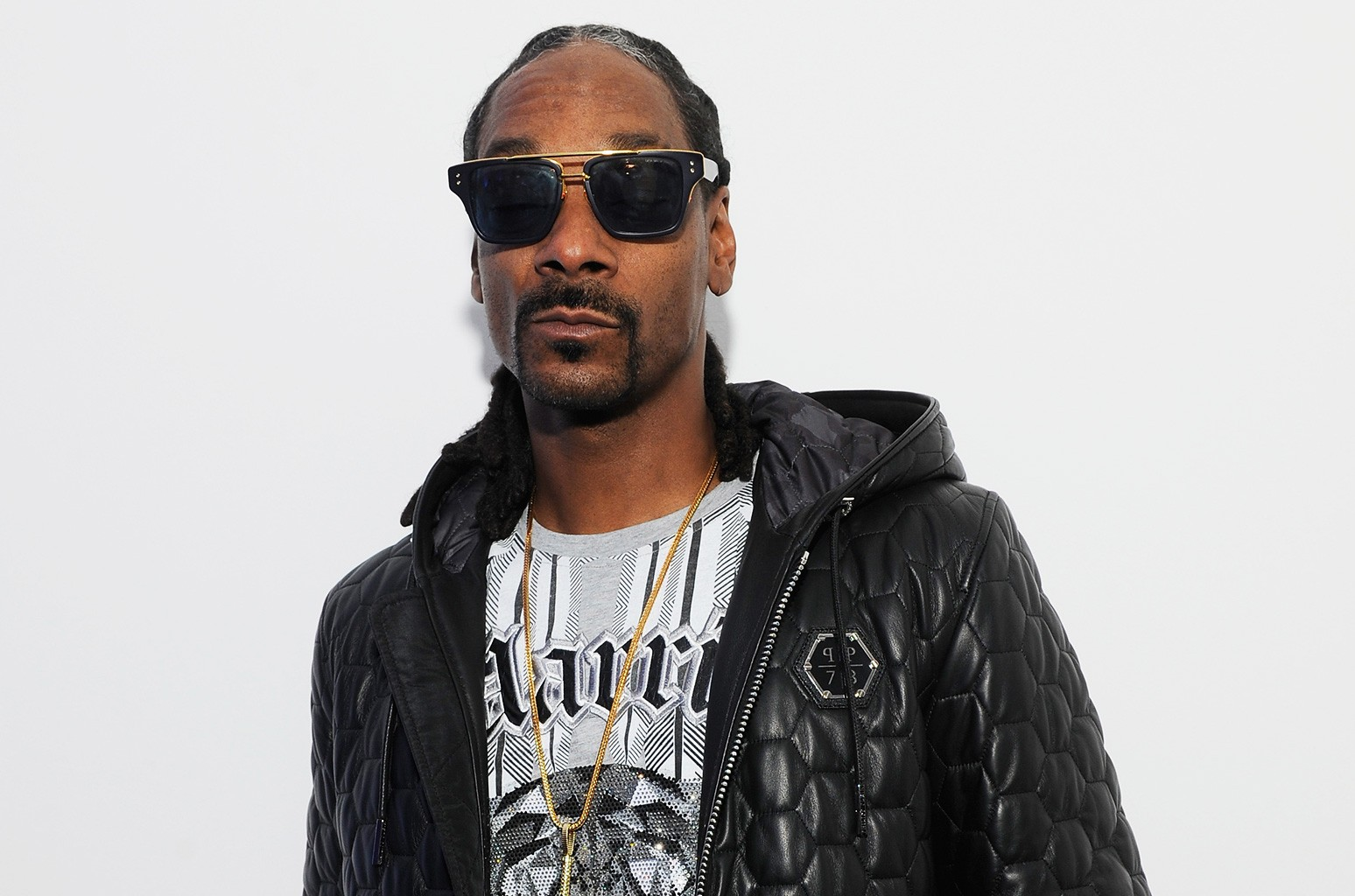 Snoop Dogg pose in backstage of the Philipp Plein Show as a part of Milan Menswear Fashion Week Fall Winter 2015/2016 on Jan. 17, 2015 in Milan, Italy.