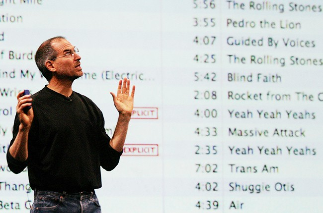 Apple CEO Steve Jobs gestures as he announces Apple 'iTunes' Music Store in the UK